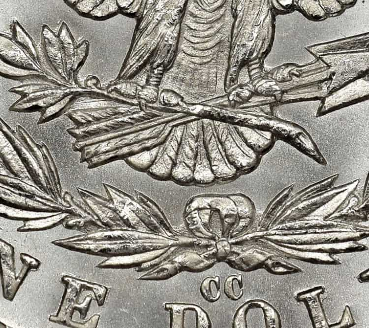 Dólar Morgan con 7 plumas