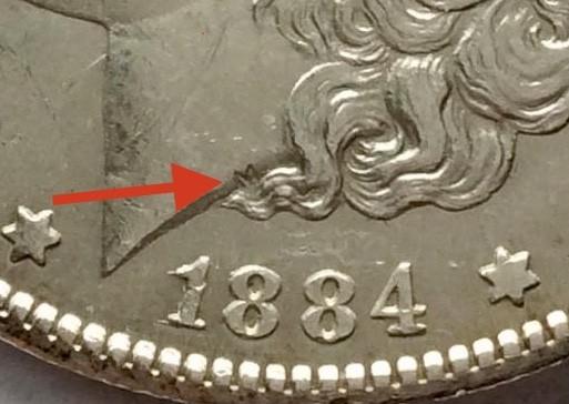 """En la base del cuello de Libertad está el monograma """"M"""" que representa la inicial de Morgan"""