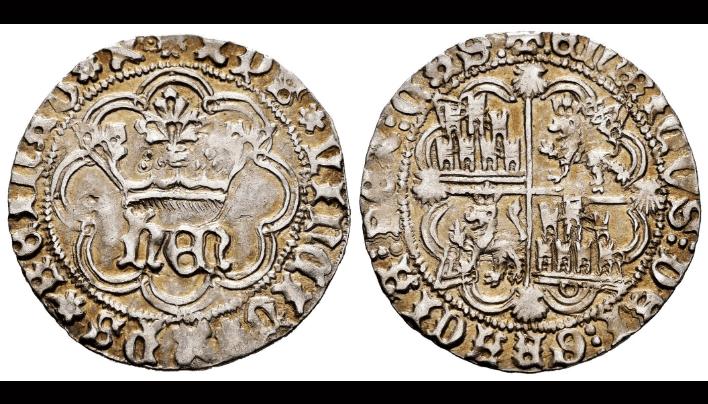 Enrique IV. 1 real de La Coruña. Cuatro veneras en reverso, ocho lóbulos en la orla del anverso.