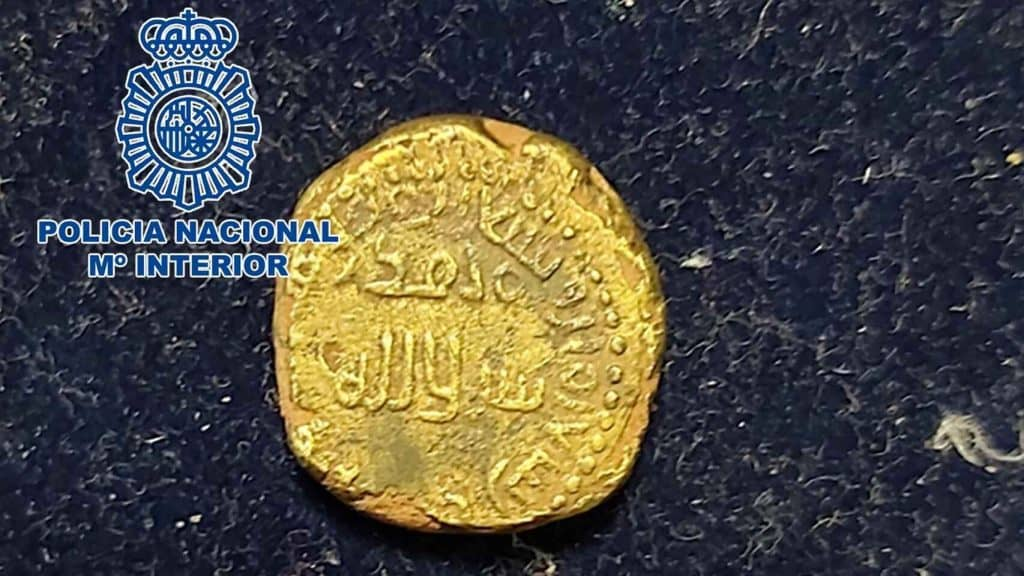 dinar bilingüe falso
